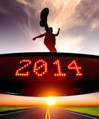 Happy new year 2014.runner jumping and crossing over matrix disp — Zdjęcie stockowe