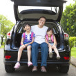 Happy family sitting in the car  — Stock Photo