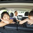 Stock Photo: Happy family sitting in the car