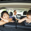 Happy family sitting in the car — Stock Photo #30654407