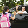 Little girl say good bye with father in front of school — Stock Photo #30654453