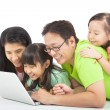Happy family with computer — Stock Photo