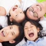 Happy family on the floor — Stock Photo #31755389