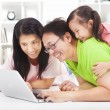Happy family with child looking at laptop — Stok fotoğraf