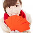 Happy girl with winter wear and holding red bag for chinese ne — Stock Photo #32632157