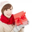 Happy young woman showing gift box — Stock Photo #32632209