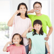 happy family brushing their teeth — Stockfoto