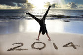 Happy new year 2014 on the beach with sunrise — Stock Photo