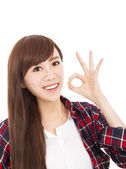 Smiling young woman with ok gesture — Stock Photo