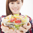 Stock Photo: Smiling young woman holding fruits and salad