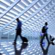 Motion blurred commuters At the airport  — Stok fotoğraf