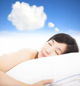Smiling and sleepy woman with dreams cloud sign — Stock Photo