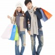 Happy couple doing shopping with winter clothing — Stock Photo
