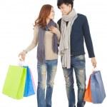 Happy couple doing shopping isolated on white — Stock Photo