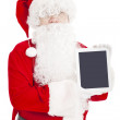 Santa claus showing tablet pc — Stock Photo #35465527