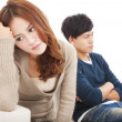Young Couple sitting on the sofa  during  conflict — Stock Photo