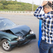 Stressed Driver looking the car After Traffic Accident — Stock Photo
