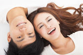 Young happy couple lying together — Stock Photo