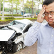 Upset driver talking on mobile phone with crash car — Stock Photo #37667919