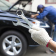 Hand holding tools and car service concept — Stock Photo #37669331