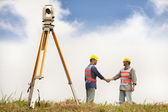 Two Surveyor engineers handshaking on the field — Stock Photo