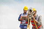 Surveyor engineer making measure with tablet pc — Stock Photo