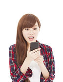 Surprised young woman watching the smart phone — Stock Photo