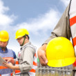 Two builder discussion the project with tablet pc — Stock Photo