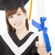 Young graduate girl student holding and showing diploma — Stock Photo #38337859