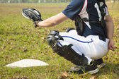 Baseball catcher ready to catch ball at home plate — Stock Photo