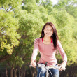 Happy young girl with bicycle outdoor portrait. — Stock Photo