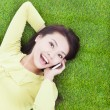 High angle view of a young woman talking with smartphone — Stock Photo