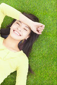 High angle view of a young woman resting on grass — Stock Photo