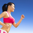 Runner woman jogging in sunny day — Stock Photo