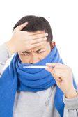 Young man with a fever and aching head,painful expression — Stock Photo