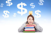 Smiling young student thinking to earn money with books — Stock Photo