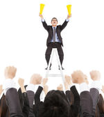 Excited businessman screaming with success business team — Stock Photo