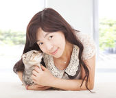 Pretty woman smiling and hug her cat — Stock Photo