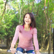 Stock Photo: Pretty girl riding bike and enjoy free time