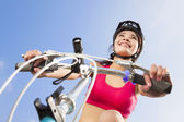 Female biker starting to ride with blue sky background — Foto de Stock