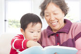 Grandmother and grandson are reading story book together — Stock Photo