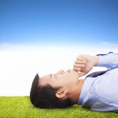 Young businessman thinking and contemplating on a meadow — Stock Photo