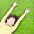 High angle view of pretty woman relaxing and lying on grass — Stock Photo