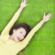 Pretty woman lying and relaxing on a meadow — Stock Photo