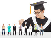 Graduation male student have different  careers to choose. — Stock Photo