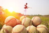 Baseball players practice wave a bat in a field — Stock Photo