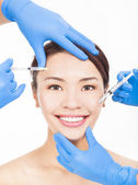 Beautiful woman gets cosmetic injections in her face — Stock Photo