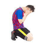 Flushed football player kneeling down — Stock Photo