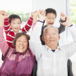 Stock Photo: Two boys playing with grandparents