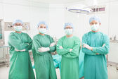 Professional surgeon teams standing in a surgical room — Stock Photo
